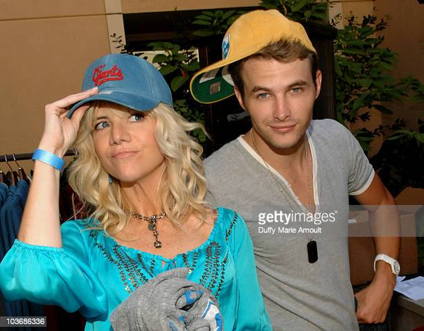 Actors Jennifer Elise Cox and James Preston pose at Retro Sport booth during Kari Feinstein Primetime Emmy Awards Style Lounge Day 2 held at Montage...