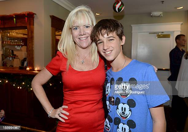 Actors Jennifer Elise Cox and Josh Feldman attend the 'Santa Paws 2 The Santa Pups' holiday party hosted by Disney Cheryl Ladd and Ali Landry at The...