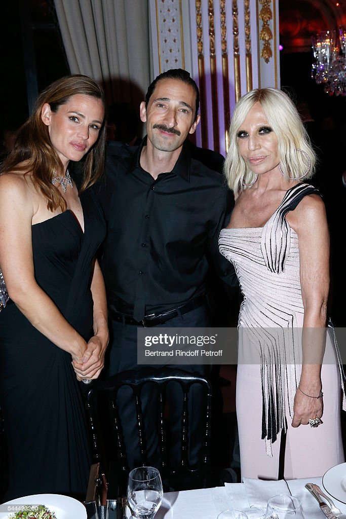 Actors Jennifer Garner, Adrien Brody and Donatella Versace attend the Amfar Paris Dinner - Stars gather for Amfar during the Haute Couture Week - Held at The Peninsula Hotel on July 3, 2016 in Paris, France.