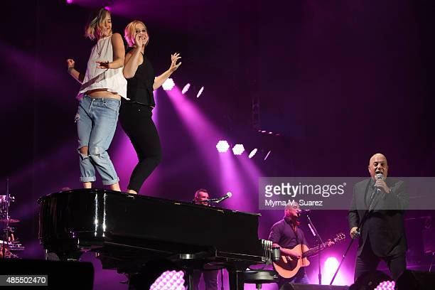 Actors Jennifer Lawrence and Amy Schumer join musician Billy Joel on stage for the encore of his sold out concert at Wrigley Field on August 27 2015...