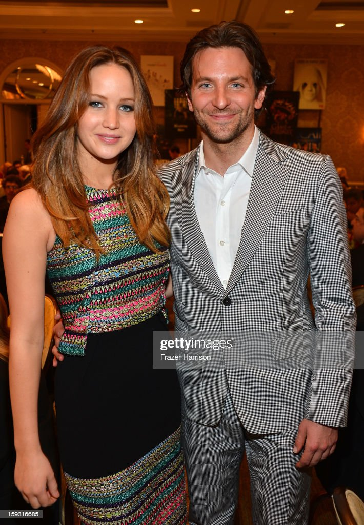 Actors Jennifer Lawrence and Bradley Cooper attend the 13th Annual AFI Awards at Four Seasons Los Angeles at Beverly Hills on January 11, 2013 in Beverly Hills, California.