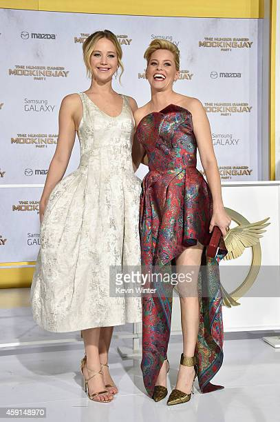 Actors Jennifer Lawrence and Elizabeth Banks attend the premiere of Lionsgate's The Hunger Games Mockingjay Part 1 at Nokia Theatre LA Live on...