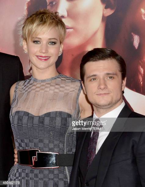 Actors Jennifer Lawrence and Josh Hutcherson arrive at the premiere of Lionsgate's The Hunger Games Catching Fire at Nokia Theatre LA Live on...