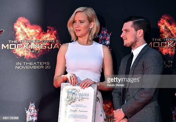 Actors Jennifer Lawrence and Josh Hutcherson attend Lionsgate's The Hunger Games Mockingjay Part 2 Hand and Footprint Ceremony at TCL Chinese Theatre...