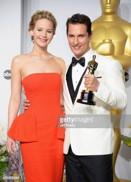 Actors Jennifer Lawrence and Matthew McConaughey pose in the press room during the Oscars at Loews Hollywood Hotel on March 2 2014 in Hollywood...