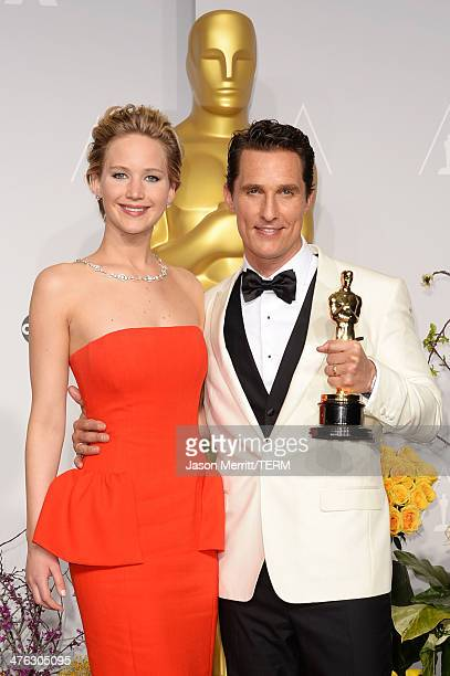 Actors Jennifer Lawrence and Matthew McConaughey winner of Best Performance by an Actor in a Leading Role poses in the press room during the Oscars...