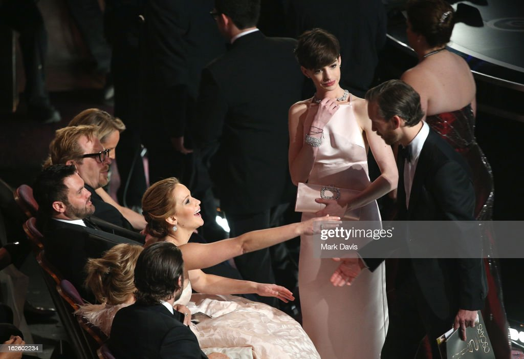 Actors Jennifer Lawrence, Anne Hathaway, and Adam Shulman attend the Oscars held at the Dolby Theatre on February 24, 2013 in Hollywood, California.