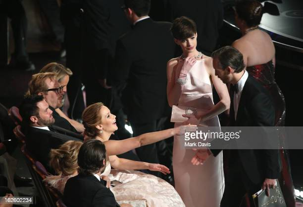 Actors Jennifer Lawrence Anne Hathaway and Adam Shulman attend the Oscars held at the Dolby Theatre on February 24 2013 in Hollywood California