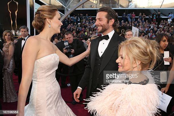 Actors Jennifer Lawrence Bradley Cooper and Gloria Cooper arrive at the Oscars held at Hollywood Highland Center on February 24 2013 in Hollywood...