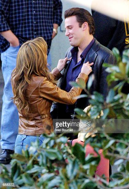 Actors Jennifer Lopez and Ben Affleck prepare to film a scene on the set of Gigli December 18 2001 in West Hollywood CA