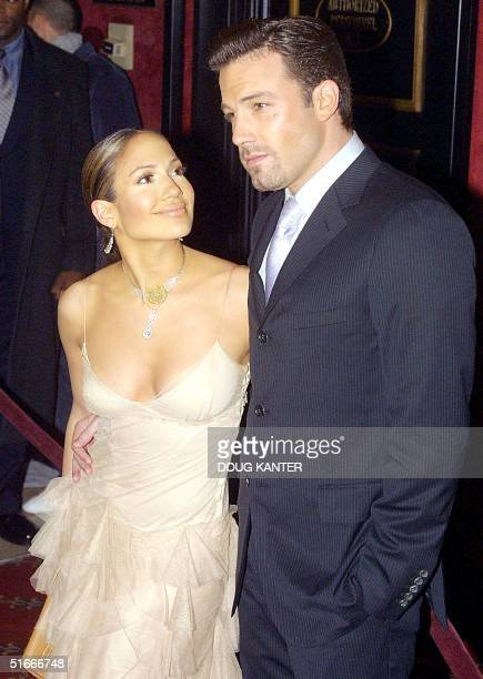 """Actors Jennifer Lopez and boyfriend Ben Affleck arrive at the premiere of Lopez's new film """"Maid in Manhattan"""" in New York 08 December 2002. AFP..."""