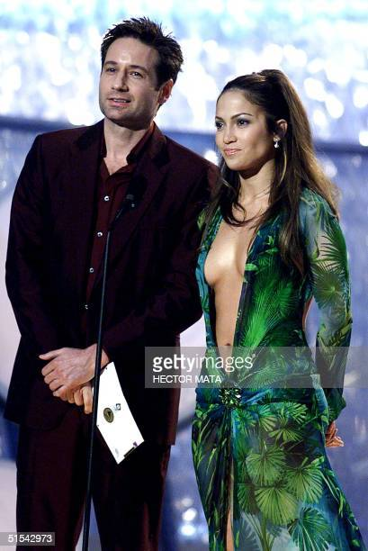 Actors Jennifer Lopez and David Duchovny present the Grammy for the category Best Rythm Blues Album during the 42nd Annual Grammy Awards in Los...