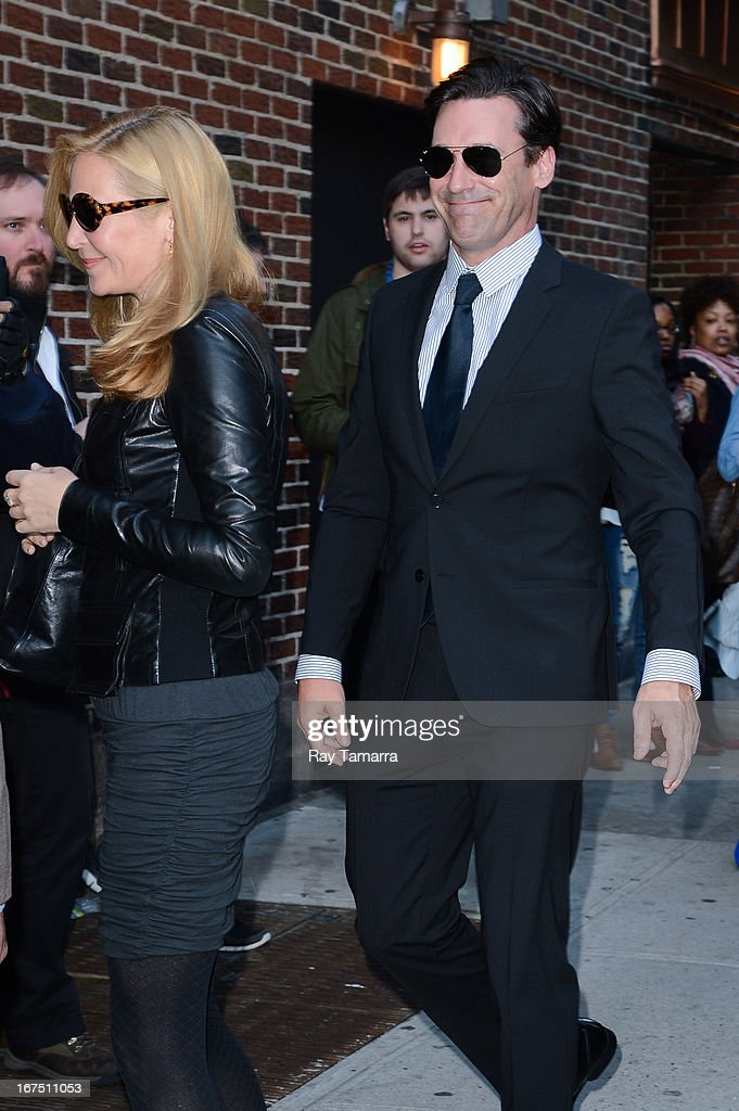 Actors Jennifer Westfeldt (L) and Jon Hamm enter the 'Late Show With David Letterman' taping at the Ed Sullivan Theater on April 25, 2013 in New York City.