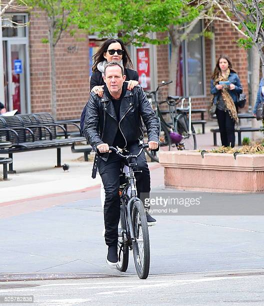 Actors Jennifer Whalen and Dean Winters are seen biking in Soho on April 28 2016 in New York City