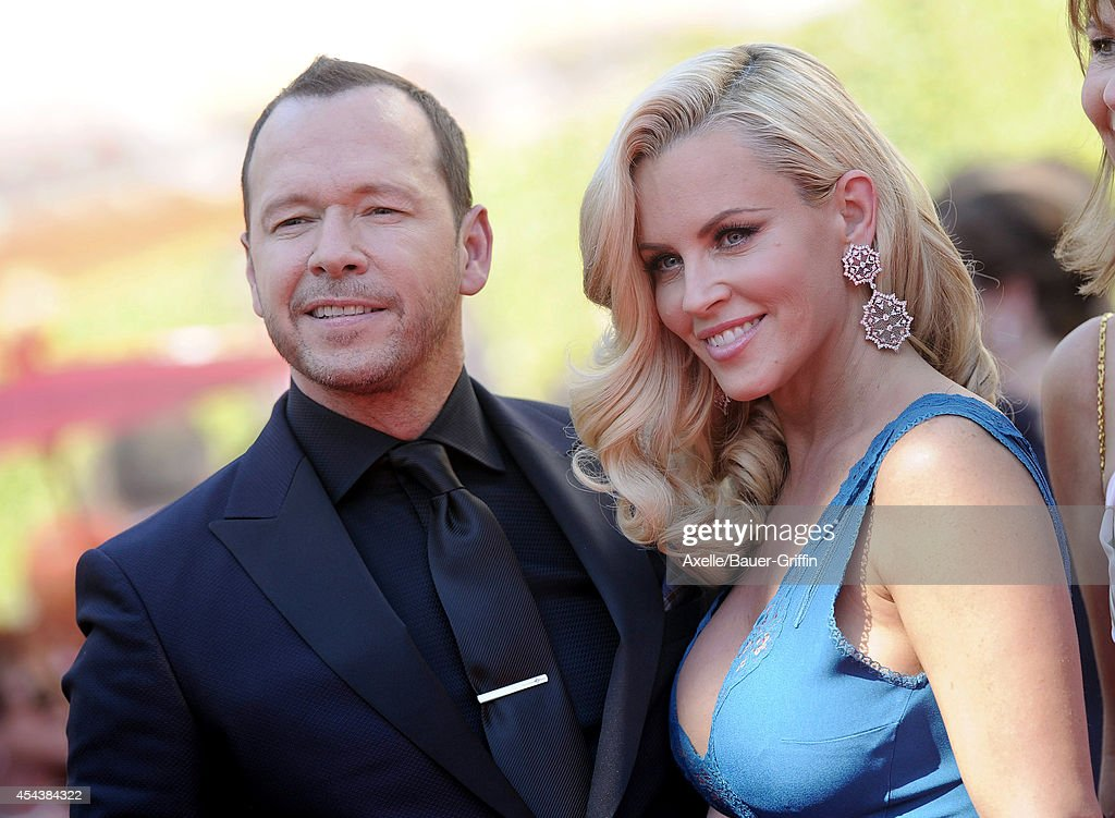 Actors Jenny McCarthy and Donnie Wahlberg arrive at the 2014 Creative Arts Emmy Awards at Nokia Theatre L.A. Live on August 16, 2014 in Los Angeles, California.