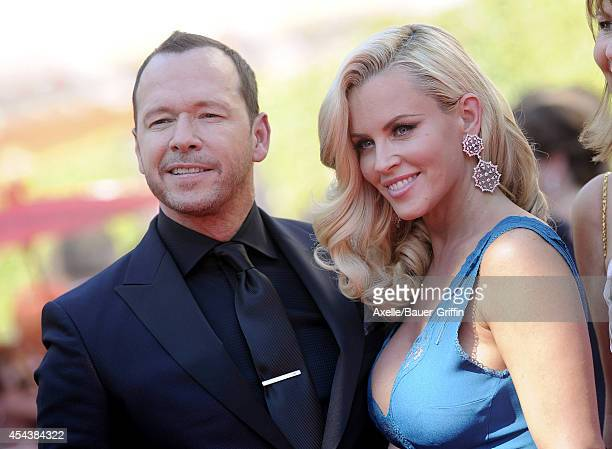 Actors Jenny McCarthy and Donnie Wahlberg arrive at the 2014 Creative Arts Emmy Awards at Nokia Theatre LA Live on August 16 2014 in Los Angeles...