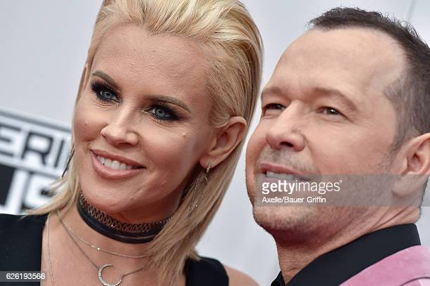 Actors Jenny McCarthy and Donnie Wahlberg arrive at the 2016 American Music Awards at Microsoft Theater on November 20 2016 in Los Angeles California