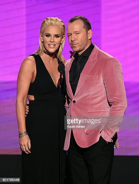 Actors Jenny McCarthy and Donnie Wahlberg present an award onstage during the 2016 American Music Awards at Microsoft Theater on November 20 2016 in...