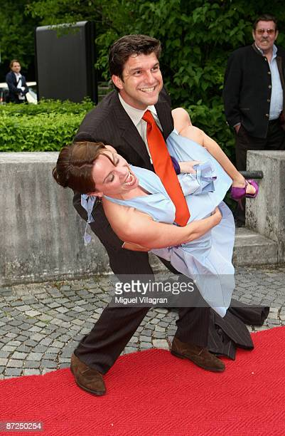 Actors Jens Peter Nuenemann and Gisa Zach joke while attending the Bavarian Television Award 'Baluer Panther' 2009 at the Prinzregententheater on May...