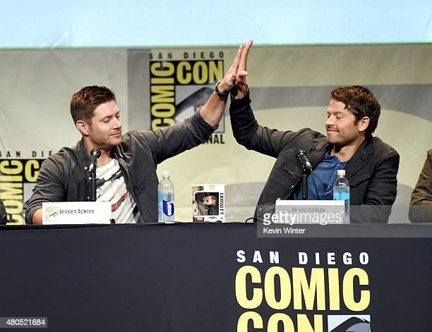 Actors Jensen Ackles and Misha Collins speak onstage at the Supernatural panel during ComicCon International 2015 at the San Diego Convention Center...