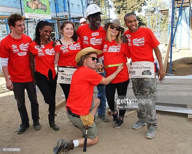 Actors Jeremy Allen White Shanola Hampton Emma Kenney William H Macy Glynn Turman Kristen Bell and Donis Leonard Jr help build homes with 'Habitat...