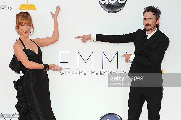 Actors Jeremy Davies and Kathy Griffin ham it up as they arrive for the 64th annual Prime Time Emmy Awards at the Nokia Theatre at LA Live in Los...