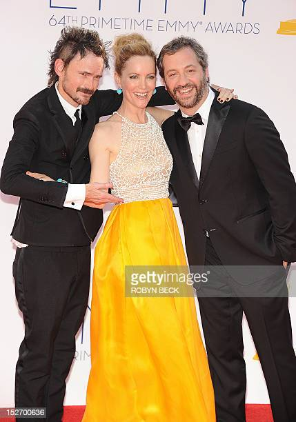 Actors Jeremy Davies Leslie Mann and director Judd Apatow arrive for the 64th annual Prime Time Emmy Awards at the Nokia Theatre at LA Live in Los...