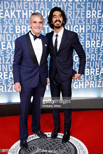 Actors Jeremy Irons and Dev Patel attend the 2017 Breakthrough Prize at NASA Ames Research Center on December 4 2016 in Mountain View California