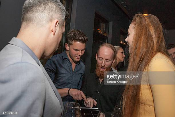 Actors Jeremy Irvine and Sophie Turner select music for a Spotify playlist at The Evening Before a preWhite House Correspondents' Dinner party hosted...