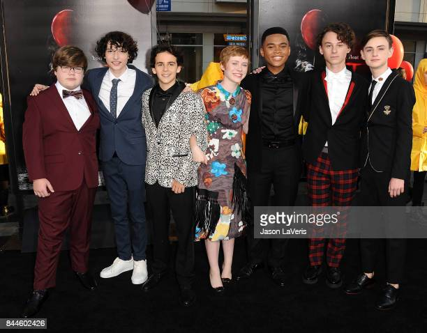 Actors Jeremy Ray Taylor Finn Wolfhard Jack Dylan Grazer Sophia Lillis Chosen Jacobs Wyatt Oleff and Jaeden Lieberher attends the premiere of 'It' at...