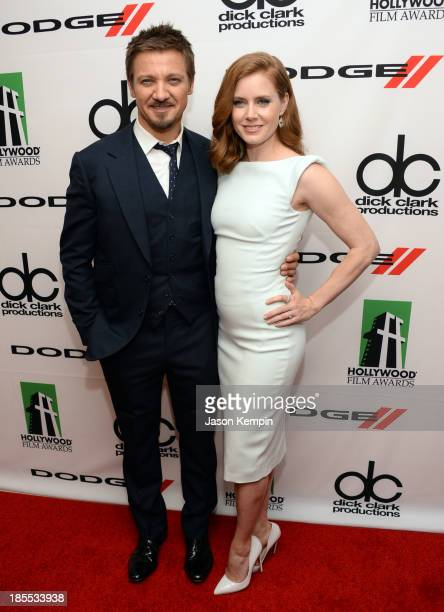 Actors Jeremy Renner and Amy Adams pose in the press room during the 17th annual Hollywood Film Awards at The Beverly Hilton Hotel on October 21 2013...