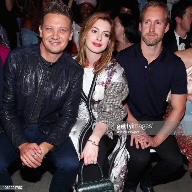 Actors Jeremy Renner and Anne Hathaway and Adam Shulman attend the Bosideng front Row during New York Fashion Week The Shows at Gallery I at Spring...