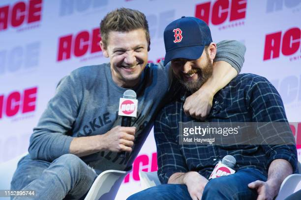 Actors Jeremy Renner and Chris Evans speak on stage during ACE Comic Con at Century Link Field Event Center on June 28 2019 in Seattle Washington