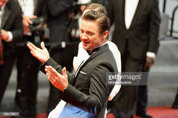 Actors Jeremy Renner and Marion Cotillard leave 'The Immigrant' Premiere during the 66th Annual Cannes Film Festival at Grand Theatre Lumiere on May...