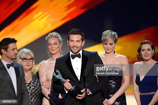 Actors Jeremy Renner Elisabeth Rohm Bradley Cooper Jennifer Lawrence and Amy Adams accept the Outstanding Performance by a Cast in a Motion Picture...