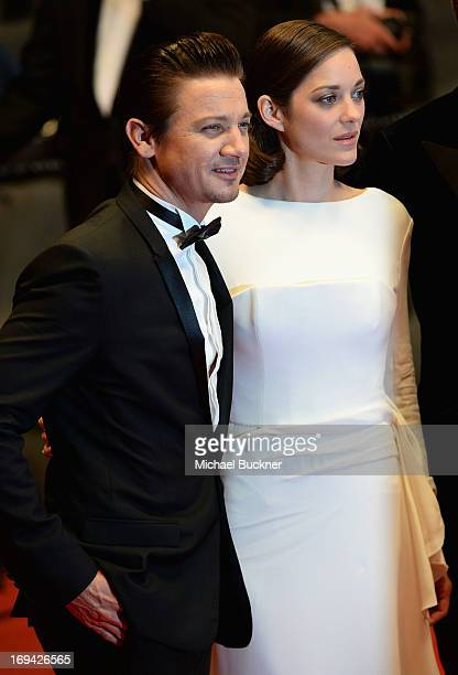 Actors Jeremy Rennerand Marion Cotillard leave 'The Immigrant' Premiere during the 66th Annual Cannes Film Festival at Grand Theatre Lumiere on May...