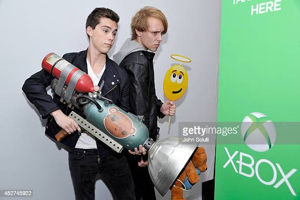 Actors Jeremy Shada and Zack Shada snap a photo with Sunset Overdrive's TNT Teddy and a Skype emoticon in the Microsoft VIP Lounge during ComicCon on...