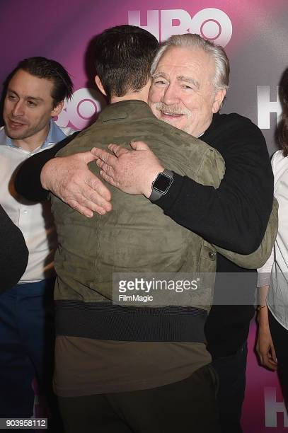 Actors Jeremy Strong and Brian Cox embrace at HBO Winter TCA 2018 on January 11 2018 in Pasadena California