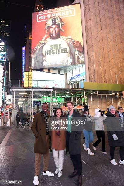 Actors Jeremy Tardy Cristina Rodlo and Sam Keeley pose in front of the 68 Whiskey billboard in Times Square during the Paramount Network 68 Whiskey...