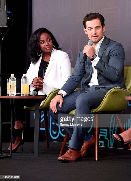 Actors Jerrika Hinton and Giacomo Gianniotti speak onstage during the Three rounds with the cast of Grey's Anatomy panel at Entertainment Weekly's...