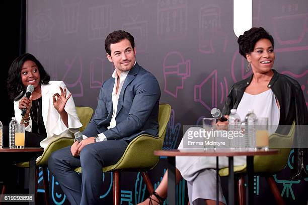 Actors Jerrika Hinton Giacomo Gianniotti and Kelly McCreary speak onstage during the Three rounds with the cast of Grey's Anatomy panel at...