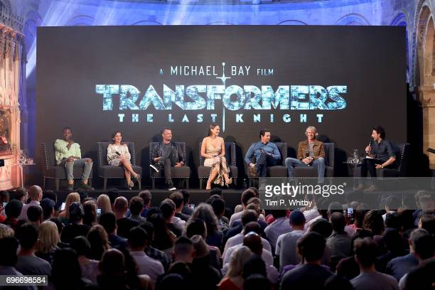Actors Jerrod Carmichael Isabela Moner Josh Duhamel Laura Haddock Mark Wahlberg film director Michael Bay and host Alex Zane attend a fan event for...