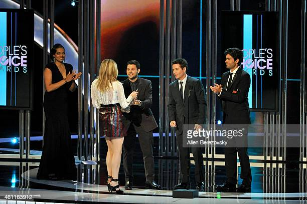 Actors Jerry Ferrara, Kevin Connolly and Adrian Grenier present actress Chloe Grace Moretz with the People's Choice Award for Favorite Dramatic Movie...