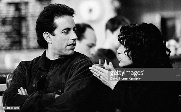 """Actors Jerry Seinfeld and Julia Louis-Dreyfus talk in between takes of the final episode on the set of the hit television show """"Seinfeld,"""" April 16,..."""