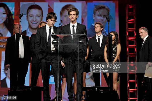 Actors Jesse Eisenberg Andrew Garfield Armie Hammer and Brenda Song accept the Ensemble Performance Award at the 22nd Annual Palm Springs...