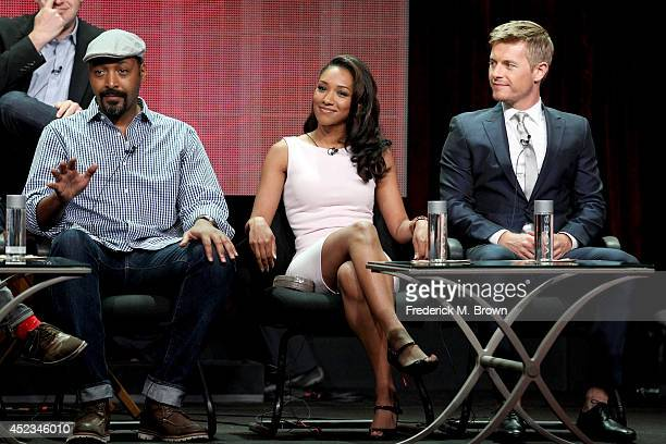 Actors Jesse L Martin Candice Patton and Rick Cosnett speak onstage at the The Flash panel during the CW Network portion of the 2014 Summer...