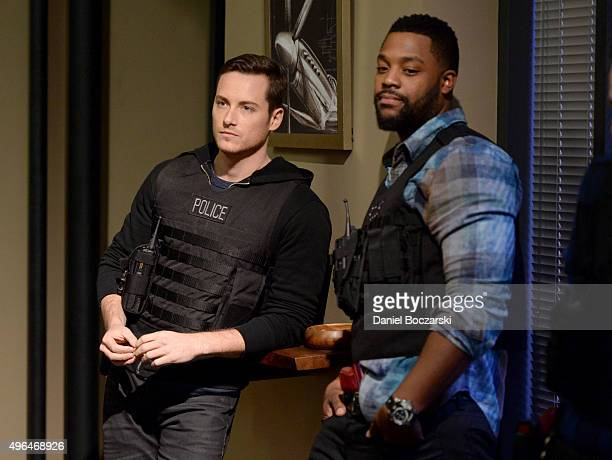 Actors Jesse Lee Soffer and Laroyce Hawkins perform an on set demonstration of 'Chicago PD' during the press junket for NBC's 'Chicago Fire' 'Chicago...