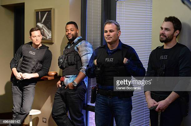 Actors Jesse Lee Soffer, Laroyce Hawkins, Chicago Police consultant Brian Luce and actor Patrick John Flueger perform an on set demonstration of...