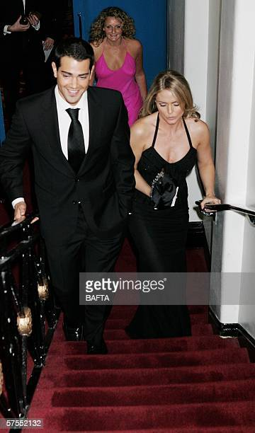 Actors Jesse Metcalf and Patsy Kensit leave the stage having been presented an award at the Pioneer British Academy Television Awards 2006 at the...