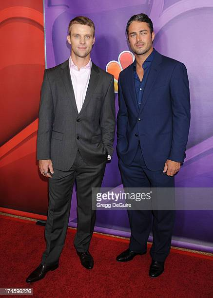 Actors Jesse Spencer and Taylor Kinney arrive at the 2013 NBC Television Critics Association's Summer Press Tour at The Beverly Hilton Hotel on July...